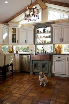 Windows as back splash / cabinets beneath & above kitchen sink in a color different from remaining cabinets