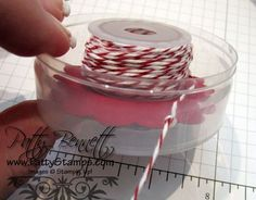 Great way to reuse empty button containers from Stampin Up and organize bakers twine!