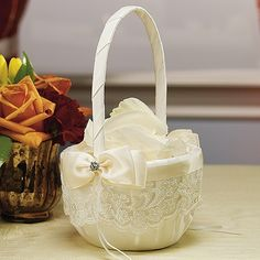 I like the idea of lace, but over a rustic basket rather than satin.