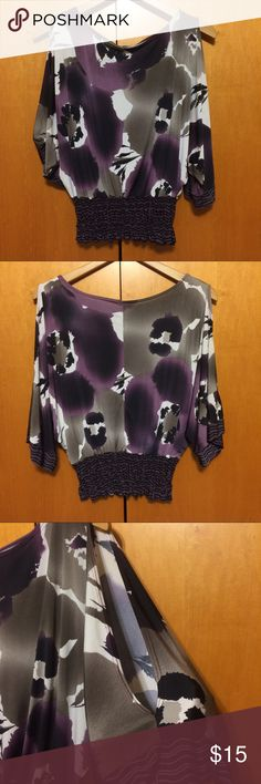 Cold Shoulder Watercolor Blouse Really pretty Watercolor Floral print in purple, gray, white and black. Cold shoulder (splits at shoulder down to elbow) 3/4 length bell sleeves. Banded elastic waist. Wide neckline. No flaws. Tops Blouses