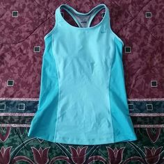 Racerback work out tank top, dri fit built in bra Ok condition. Nike logo is peeling off a little, hardly worn. Nike Tops Tank Tops