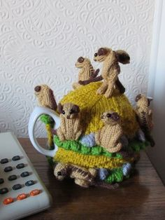 The meerkat tea cosy depicts a mod of meerkats gathered on the top of their burrow. https://www.crazypatterns.net/en/items/37567/meerkat-tea-cosy