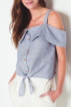 Blue stripe printtop with cold-shoulder cut-out on short sleeves supported by thick straps. Fold-over detail on shoulder band. Button-down front closure with additional knot tie detail.   Sorrow Cold Shoulder Top by Movint. Clothing - Tops - Blouses & Shirts Los Angeles, California