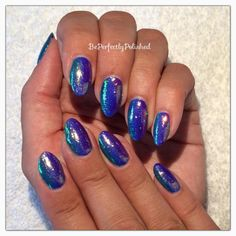 We are loving these gorgeous #nails by Vikki Carey. She has used Lecente #glitter in Capri Iridescent over a Gelish ombre of Tahiti Hottie, Mali blue me away and garden teal party. #nails #nailart #lovelecente