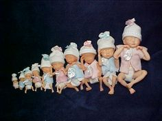 Embryo and foetus dolls dressed in baby clothes as if they are already newborn infants