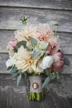 pretty, romantic, girly ~ Love this idea for a wedding bouquet and pinning Grandma's cameo on the hand grip. ♥