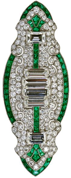 Art Deco Diamond Emerald Brooch. It's all about geometry and calibrated shapes. The french curves keeping company with their defined deco counterparts. All this surrounds six bold baguette shaped diamonds of ~5.50 carats.  Via @1stdibs.