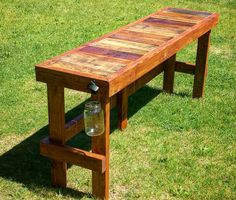 """In this Instructable I'll demonstrate how to build an outdoor bar/table with a reclaimed pallet wood top. This project is relatively simple and can be completed in just a few days (with dry times for the stain and varnish). I specifically made this bar to sit next to a hot tub so it is 6 feet long, 18 inches deep, and about 30.5 inches high. (The hot tub is 76"""" long on one side and 31.5"""" high).Materials:Five 2x4x8's (green treated outdoor lumber)Two 1/2x1x8's (green treated outdoor..."""