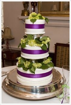 This is a beautiful wedding cake using a dark purple ribbon and green hydrangeas. Description from flower-arrangement-advisor.com. I searched for this on bing.com/images