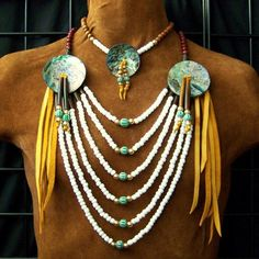 Loop necklace is adorned with large abalone discs, old style glass trade beads, brass beads, amber hairpipe (greenish cast ), wood beads, reproduction old trade beads, soft (gold) deerskin.