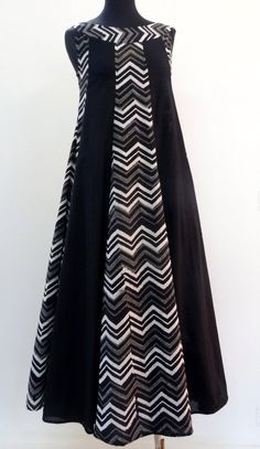 Mid-length dress with printed black and white cotton sleeveless in round neck. - - Mid-length dress with printed black and white cotton sleeveless in round neck. Batik Fashion, Abaya Fashion, Muslim Fashion, Fashion Dresses, Abaya Mode, Hijab Stile, Muslim Dress, Batik Dress, Mid Length Dresses