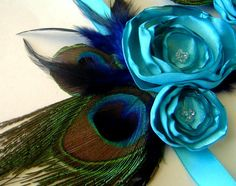 This would match my dress perfectly :)!  Peacock Corsage & Boutonniere Bridal Party Set by maggpieseye, $30.00