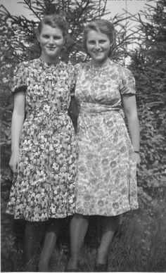 Two younger German women in typical dresses for the era. All-over prints in florals or geometric patterns were common, and these ladies are likely wearing cotton or rayon.