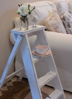#Small #Vintage #Stepladder painted a crisp white and used as a side table in the Living room area to rest small objects on.