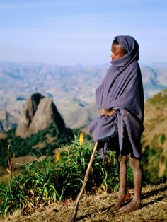 blues, indigo, browns, greens, yellow ((shepherd boy in Simien Mountains)) We Are The World, Countries Of The World, Parc National, National Parks, Horn Of Africa, West Africa, Mountain Background, Cultural Identity, People Of Interest