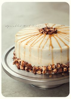 """chocolate """"snickers"""" layer cake... chocolate cake with cream cheese frosting, caramel sauce, and peanuts"""