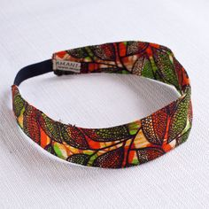 A bright headband handmade from Kitenge, an African garment similar to sarong, often worn by women wrapped around the chest or waist, over the head as a headscarf, or as a baby sling. African Accessories, African Jewelry, Fashion Accessories, Hair Accessories, Rope Jewelry, Fabric Jewelry, Style Africain, African Crafts, Techniques Couture