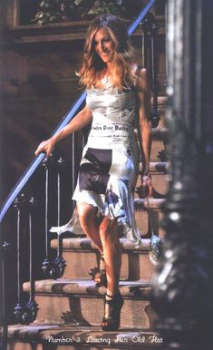 I've been obsessed with this John Galliano for CD newspaper dress for EONS!  Amazing blog on the SATC2 outfits