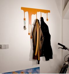 Looking for coat hooks to put in Walt's corner of the living room. Like this because we can hang it low for a while and then put it up higher as Walt grows. Has both a kid and art feeling too it.