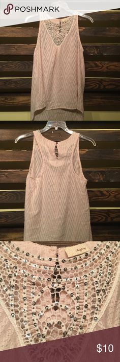 Daytrip dressy high low tank top This is a lightly warn daytrip dressy tank top. It has a peachy cream color, this tank top is accented with a crocheted and studded top. The back has a key hole. Size medium, very good condition. Open for offers. Daytrip Tops Blouses
