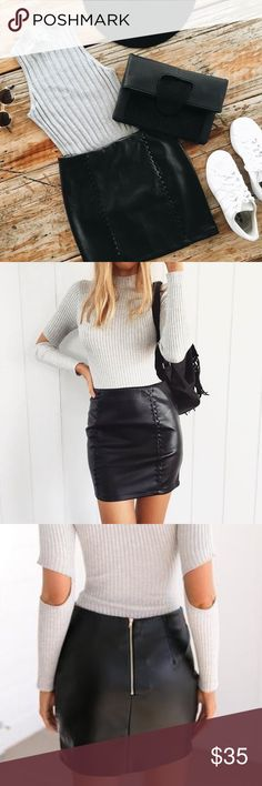 NEW! Black Out Vegan Leather Skirt DETAILS: 📸 Mura Boutique; please note AUS sizing! 8=S; 10=M, 12=L. I would recommend sizing up!  Stunning black vegan leather mini skirt Criss cross detailing at front Visible zipper at back Not lined, thick material  FIT: Regular fit No stretch to fabric 100% Polyester  CARE INSTRUCTIONS: Cold gentle hand wash Do not tumble dry Cool iron Dry clean recommended Follow care instructions  MODEL MEASUREMENTS: Model wears size 8 Height: 174 cm Dress: AU 8 Bust…