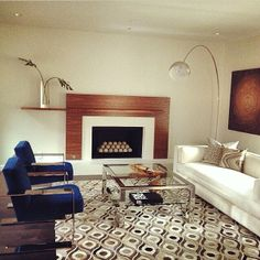 Modern, casual comfort never looked so good! Pulp Designs created this contemporary living space and incorporated a Surya Appalachian Collection rug. (APP-1003)