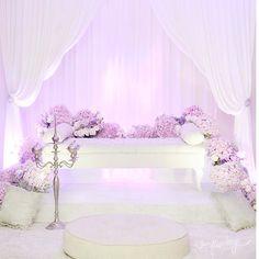 white and purple dais