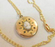 VICTORIAN GOLD FILLED MARKED D.C.&.CO.12-SEED PEARLS 4-STONES SHELL CAMEO LOCKET
