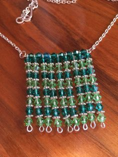 This dressy necklace is handcrafted by Dallas using Czech fire-polished glass beads in a square pattern.    Green Clear & Silver tone Chain. | Shop this product here: http://spreesy.com/DallasFranklin/33 | Shop all of our products at http://spreesy.com/DallasFranklin    | Pinterest selling powered by Spreesy.com