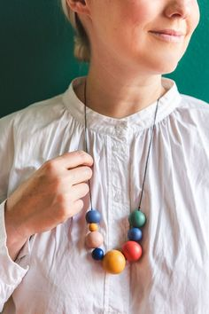 Brittany is wearing a white blouse and a rainbow colored clay necklace. She's standing against a green wall. Cute Crafts, Crafts To Do, Diy Fashion Accessories, Polymer Clay Projects, Diy Schmuck, Teacher Appreciation Gifts, Creative Photos, Clay Beads, Creative Inspiration