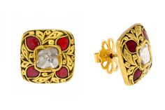 A Pair of Ear Tops crafted in Gold and set with Valandas and cob Ruby