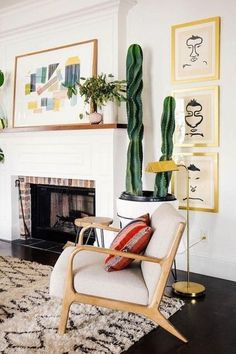 These are the top home decor trends on pinterest that you can add to your home ASAP. We love these prints paired with this mid-century modern chair (and the indoor cactus of course!).