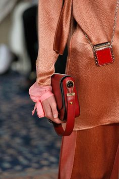 Micro Bags Are Getting Smaller & Smaller #refinery29 http://www.refinery29.com/2016/10/125135/valentino-baby-bags-pfw-spring-2017#slide-4 One that's practical, one that's...not so much....