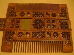 Liturgical combs were also made of wood, some with mirrors in the middle or ivory inlay.. The wood appears to be about 1/2 inch thick in the middle, tapering to 1/8 at the tips of the teeth. These 15th Century combs reside in The Musée National du Moyen Age – Thermes de Cluny.