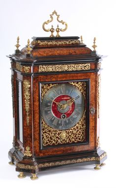 Swiss mulberry ormolu mounted quarter repeating alarm table timepiece, J. Robert, circa 1700. 8-day spring driven movement, pull wind quarter repeating on two bells, pull wind alarm on a bell, mulberry veneered case with ormolu mounts.