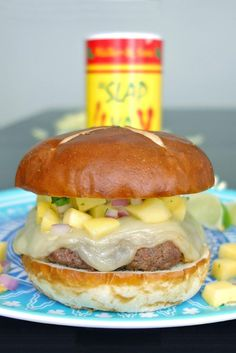 The Islander Burger combines sweet mango salsa and spicy cajun seasoning. Burger Meat, Hamburger Buns, Creamy Cheese, Cajun Seasoning, Mango Salsa, 4 Ingredients, Grilling Recipes, Spice Things Up, Food To Make