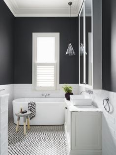 Beautiful and modern black and white bathroom with white subway tiles from Dulux colour gallery. Love the detailing on the floor!