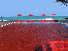 The Red Pool at The Library - Koh Samui, Thailand! Once you realize that this pool is not actually filled with blood, and that the effect is created by intricate tiling instead of dye, the pool takes on a truly unique sense of beauty. Click through to see 20 more of the best pools on earth!
