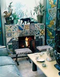 This tiled fireplace is so gorgeous.... Florence Grinda-Paris Apt-Pierre Passebon-Russian AD