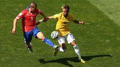 Francisco Silva of Chile challenges Neymar of Brazil