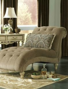 Create a living room that's sure to turn heads, with luxurious pieces like a plush chaise. With its shapely design and thick tufted cushion, you'll want to spend hours relaxing on it.