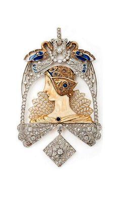 Lluis Masriera | An important gold, ivory, plique-a-jour enamel, diamond and sapphire pendant.  Barcelona, circa 1910.