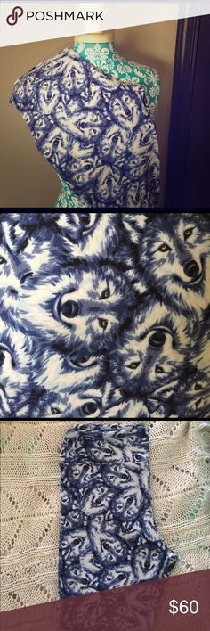 🦄 LuLaRoe TC Blue Wolf Leggings 🐺 🦄 LuLaRoe TC Blue Wolf Leggings 🐺 Very THICK & Soft-not the newer thin, silky pairs. They remind me of a flannel, cotton. See the last pic for the different texture the material has. Only worn once & washed per LLR standard. BEAUTIFUL Blue wolves with different blue shades and some white, with piercing green, yellow eyes! 💙 Bundle for a discount! **CROSS POSTED** LuLaRoe Pants Leggings