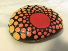 Medium size hand painted dot mandala stone by MadeleineMagill
