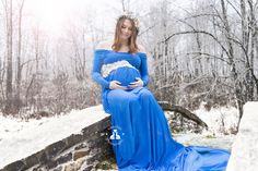 SBurritt Photography Canada outdoor winter maternity old stone bridge snow covered blue gown fancy maternity