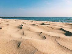 golden sand on outlet beach in sandbanks provincial park