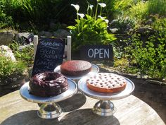 Open now... Spiced Chocolate Cake, Raspberry Torte and Ginger Cake all just about cool and ready to be eaten!  #Islay