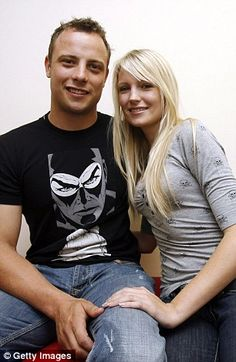 South African Paralympic athlete Oscar Pistorius poses with his girlfriend Jenna Edkins on...