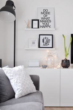 Black floor lamp and white side cabinet.