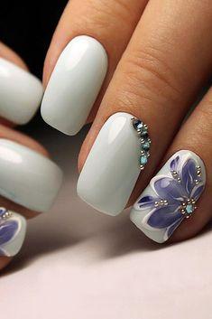 nail design white with lilac flowers and rhinestones masternailsira via instagram